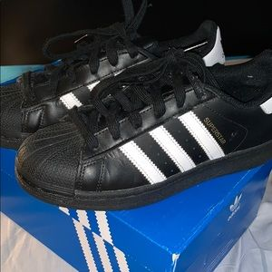 Black and white gently used adidas